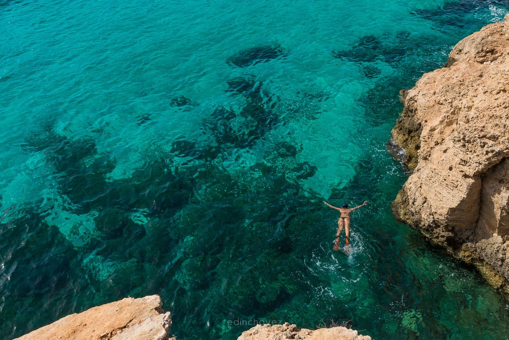 swimmer at the blue lagoon in Malta goes snokeling in the amaizng blue waters