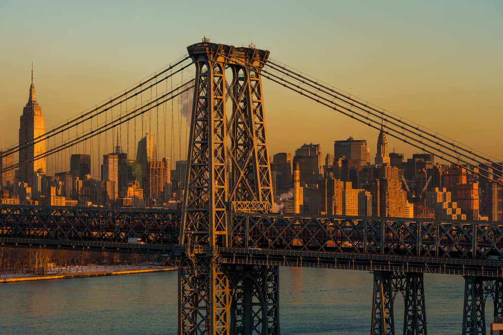 NYC behind the Williamsburgh Bridge at sunrise