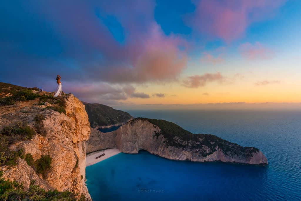 Photo of girl on navagio shipwreck beach